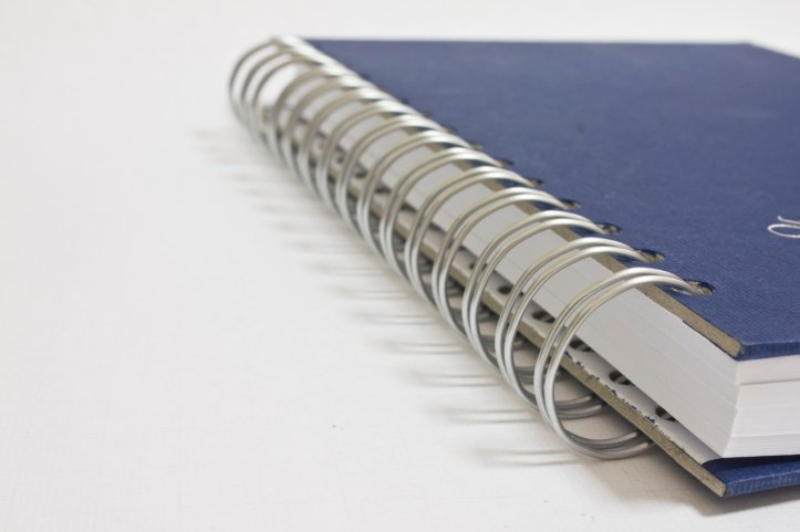 notebook-wih-spiral-and-blue-cover-1236579